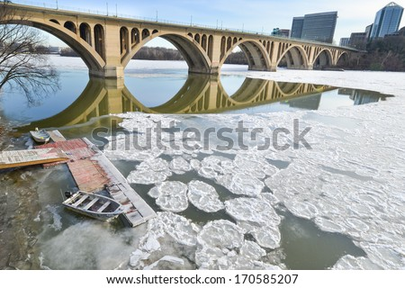 Washington DC - Francis Scott Key Bridge over frozen Potomac River in Winter season - stock photo