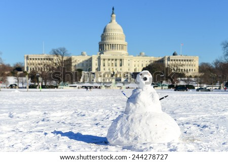 Washington DC in Winter - Snowman in front of  the Capitol  Building - stock photo