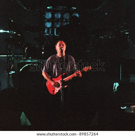 WASHINGTON DC - JULY 10: The band Pink Floyd plays in concert at RFK Stadium in Washington, D.C. on Sunday, July 10, 1994. The band members included  David Gilmour,  Nick Mason,  Roger Waters, and Richard Wright. very noisy - stock photo