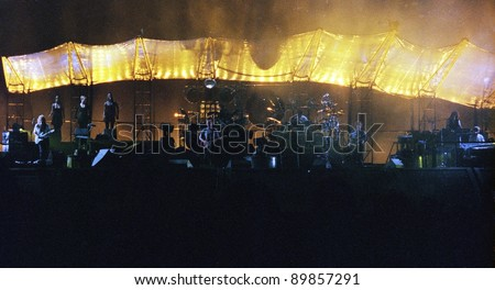 WASHINGTON DC - JULY 10: The band Pink Floyd plays in concert at RFK Stadium in Washington, D.C. on Sunday, July 10, 1994. The band members included  David Gilmour,  Nick Mason,  Roger Waters, and Richard Wright. - stock photo