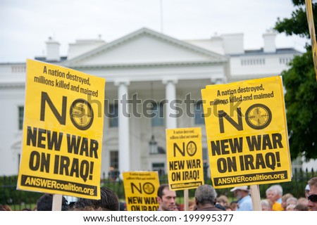 WASHINGTON, DC- JUNE 21: Anti-war demonstrators protest in front of the White House in Washington, DC on June 21, 2014. - stock photo