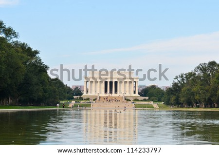 Washington DC, Lincoln memorial and its water reflection - stock photo