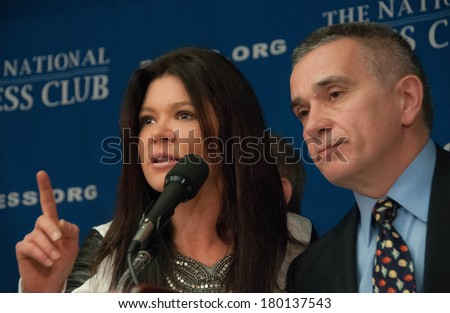 WASHINGTON, DC - MARCH 5, 2014:  Ukrainian pop singer and democracy activist Ruslana Lyzhychko, accompanied by an interpreter, speaks at a press conference at the National Press Club - stock photo