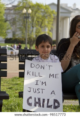 WASHINGTON, DC - MARCH 25: Unidentified family protests at White House after U.S. Army Staff Sargent Robert Bales charged, 17 counts of murder killing 8 adults and 9 children in Afghanistan. Washington, DC, March 25, 2012 - stock photo