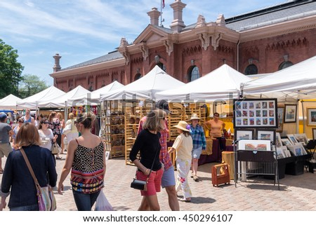 WASHINGTON DC-May 24, 2015: Historic Eastern Market in the Capitol Hill area, first opened in 1805. The outdoor artisan stalls and indoor food market attract a diverse crowd of visitors and locals. - stock photo