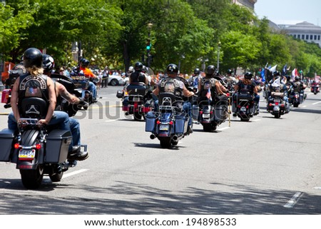 WASHINGTON, DC - MAY 25: Motorcycles travel in DC as part of the annual Rolling Thunder motorcycle Ride for Freedom� for American POWs and MIA soldiers on May 25, 2014 in Washington, DC. - stock photo