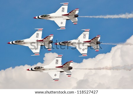 WASHINGTON DC - MAY 8:USAF Thunderbirds F-16 showing precision of formation flying during the airshow on May 8, 2012. Squadron was formatted on May 25, 1953. Currently they are based at Nellis AFB. - stock photo