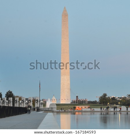 Washington DC, National Mall evening scene including World War II Memorial, the Monument and Capitol Building  - stock photo
