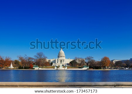 WASHINGTON DC - NOV 29: The United States Capitol behind the Capitol Reflecting Pool on Nov 29, 2013 in Washington DC, USA. It is the meeting place of the United States Congress - stock photo