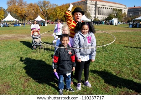 WASHINGTON, DC - NOVEMBER 07: Alzheimer's Walk event on November 07, 2011 in Washington DC, USA. Unidentified Children playing during a fund raising event, and entertainment to help find Alzheimer's cure. - stock photo