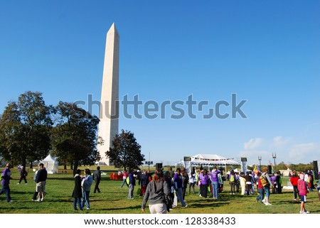 WASHINGTON, DC - OCTOBER 18: Alzheimer's Walk Event on October 18, 2008 in Washington, DC USA. People walking at the Washington DC Monument during a fund raising event to end Alzheimer's disease - stock photo