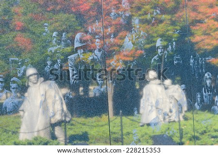 WASHINGTON DC - OCTOBER 19, 2014: Korean War Veterans Memorial located in National Mall in Washington DC. The Memorial commemorates those who served in the Korean War.  - stock photo