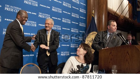 WASHINGTON, DC - OCTOBER 31: Republican Presidential contender Herman Cain is congratulated by campaign manager Mark Block after a speech at the National Press Club, October 31, 2011 in Washington, DC - stock photo