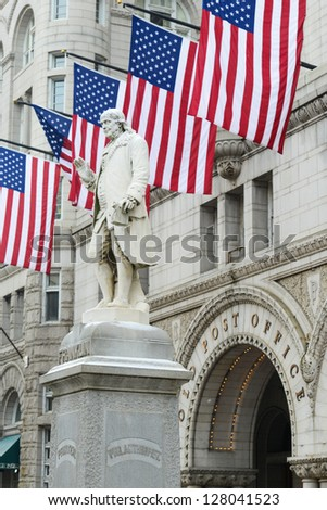 Washington DC, Old Post Office building with Benjamin Franklin Statue foreground - stock photo