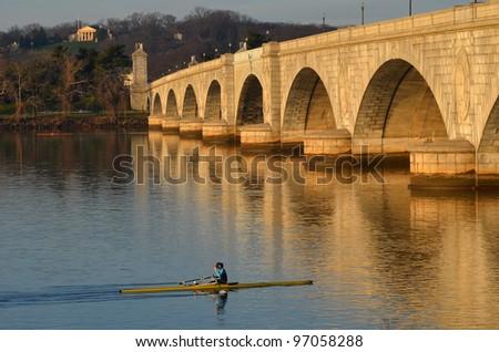 Washington DC, rowing boat in Potomac River with Arlington Memorial Bridge view - stock photo