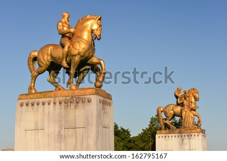 Washington DC, statues at the Lincoln Memorial end of the Memorial Bridge on Potomac river  - stock photo