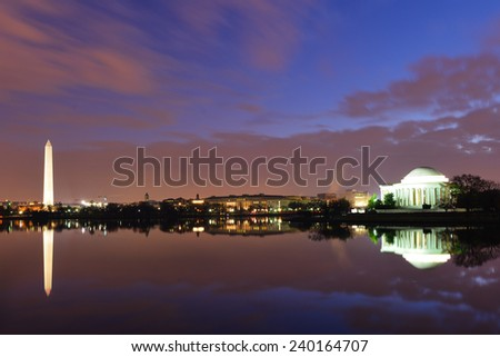 Washington DC - Thomas Jefferson Memorial  and Washington Monument at night with mirror reflections on water.  - stock photo