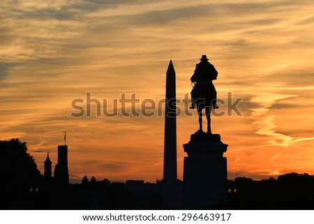 Washington DC - Ulysses S. Grant Memorial and Washington Monument silhouettes in sunset  - stock photo