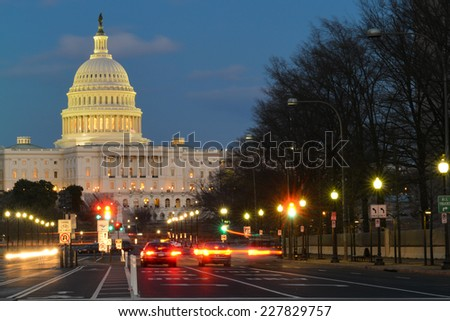 Washington DC, United States Capitol building night view from from Pennsylvania Avenue with car lights trails  - stock photo