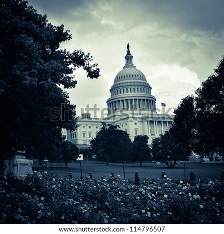 Washington DC, United States Capitol Building with dramatic clouds - toned - stock photo