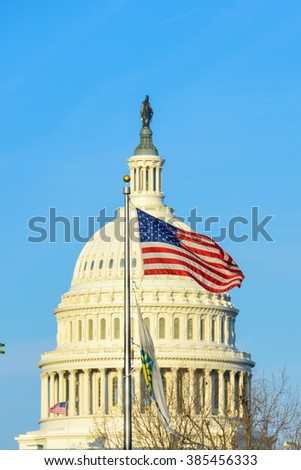Washington DC - United States national flag with US Capitol Building dome background - stock photo