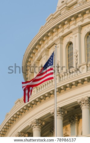 Washington DC - US Capitol building detail with US flag - stock photo