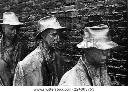 WASHINGTON DC, USA - JULY 17, 2014: A detail from a statue group at the Franklin Delano Roosevelt Memorial that portrays the depth of the Great Depression. (Scanned from black and white film.) - stock photo