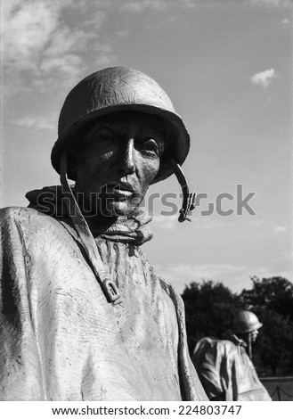 WASHINGTON DC, USA - JULY 17, 2014: The gaunt and harrowed bronze sculpture of a soldier on patrol is part of the Korean War Memorial in Washington, DC. (Scanned from black and white film.) - stock photo
