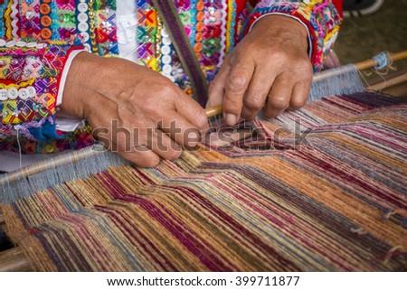 WASHINGTON, DC, USA - JUNE 28, 2015: Woman from Cusco, Peru demonstrates weaving with backstrap loom (awana), during 2015 Smithsonian Folk Life Festival. - stock photo