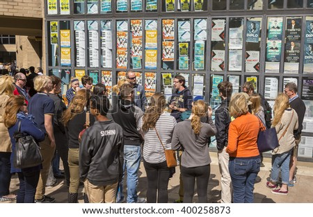 WASHINGTON, DC, USA -  MARCH 30, 2016: Parents and prospective students listen to guide during campus tour, George Washington University. - stock photo