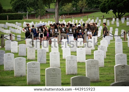 Washington DC, USA - May 31, 2016: Group of students visit the gravestones at Arlington National Cemetery the day after Memorial Day. - stock photo