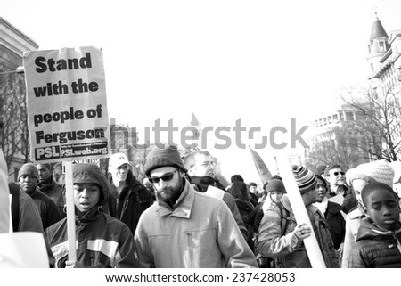WASHINGTON - DECEMBER 13: Protesters march against police shootings and racism during a rally in  Washington, DC on December 13, 2014  - stock photo