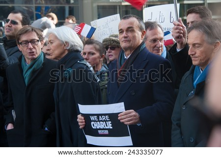 WASHINGTON - JANUARY 11: Gerard Araud, French ambassador to the United States, participates in a silent protest against the terror attacks in Paris in Washington, DC on January 11, 2015 - stock photo