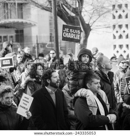 WASHINGTON - JANUARY 11: Protestors march silently against the terror attacks in Paris in Washington, DC on January 11, 2015 - stock photo