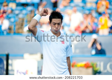 WASHINGTON - JULY 30: Kei Nishikori (JPN) after his defeat over Sam Querrey (USA, not pictured) at the Citi Open tennis tournament on July 30, 2014 in Washington DC - stock photo