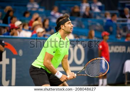 WASHINGTON -JULY 29: Marinko Matosevic during his losing match to fellow Australian Lleyton Hewitt (not pictured) at the Citi Open tennis tournament on July 29, 2014 in Washington DC - stock photo