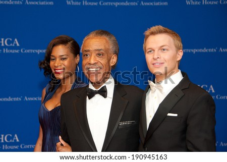 WASHINGTON MAY 3 - Aisha McShaw, Al Sharpton and Ronan Farrow on the red carpet at the White House Correspondents� Association Dinner May 3, 2014 in Washington, DC - stock photo