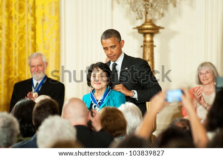 WASHINGTON - MAY 29: Civil rights and women's advocate, Dolores Huerta, receives the Presidential Medal of Freedom at a ceremony at the White House May 29, 2012 in Washington, D.C. - stock photo