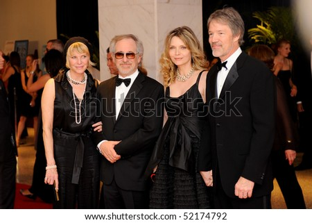 WASHINGTON MAY 1 - Kate Capshaw, Steven Spielberg, Michelle Pfeiffer and David Kelley arrive at the White House Correspondents Association Dinner May 1, 2010 in Washington, D.C. - stock photo