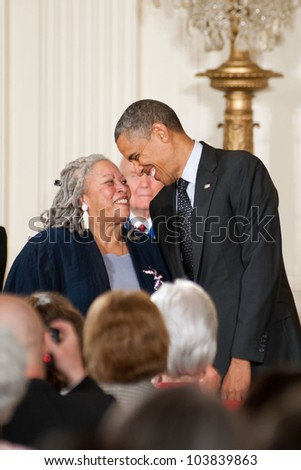 WASHINGTON - MAY 29: Novelist Toni Morrison smiles at President Obama as she waits to receive the Presidential Medal of Freedom at a ceremony at the White House May 29, 2012 in Washington, D.C. - stock photo