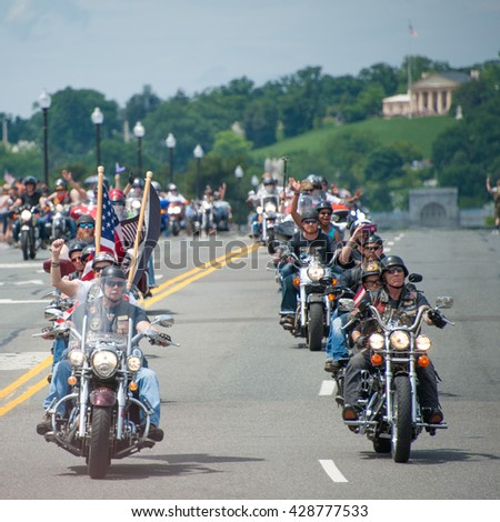 WASHINGTON MAY 29: Riders take part in Rolling Thunder, a motorcycle rally to bring attention to POWs and MIAs of US-involved wars, on May 29, 2016 in Washington, DC.   - stock photo