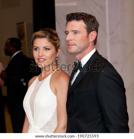 WASHINGTON MAY 3 � Scott Foley and Marika Domincyk arrive at the White House Correspondents� Association Dinner May 3, 2014 in Washington, DC - stock photo