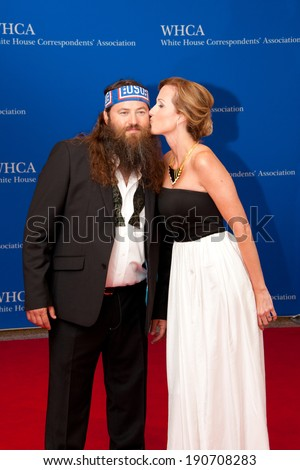 WASHINGTON MAY 3 � Willie Robertson gets a kiss from wife Korrie at the White House Correspondents� Association Dinner May 3, 2014 in Washington, DC - stock photo