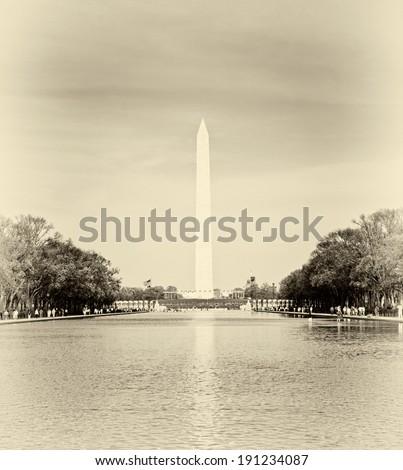 Washington monument in front of reflecting pool vintage style - stock photo