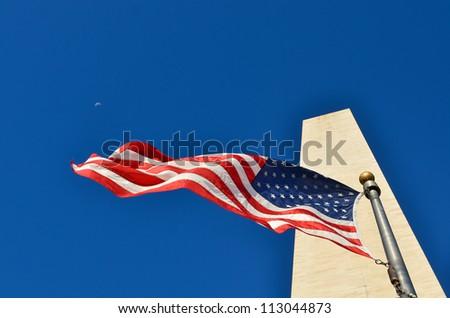 Washington Monument with waving US flag in Washington DC United States - stock photo