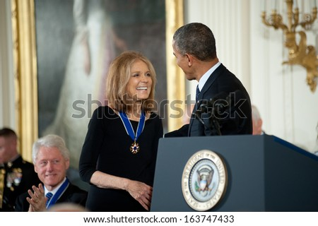 Washington -Â?Â? November 20: Gloria Steinem is congratulated after receiving the Presidential Medal of Freedom from President Obama at The White House on November 20, 2013 in Washington, DC.  - stock photo