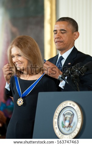 Washington � November 20: Gloria Steinem receives the Presidential Medal of Freedom from President Obama at a ceremony at The White House on November 20, 2013 in Washington, DC.  - stock photo