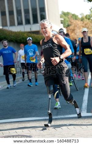 WASHINGTON - OCTOBER 27: A double amputee runs in the Marine Corps Marathon on October 27, 2013 in Washington, DC - stock photo