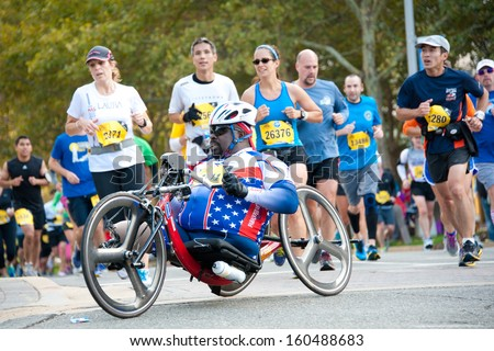 WASHINGTON - OCTOBER 27: A hand cyclist competes in the Marine Corps Marathon on October 27, 2013 in Washington, DC - stock photo