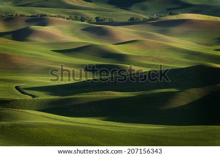 Washington Palouse.. The view of the farmland in eastern Washington as seen from Steptoe Butte State Park at sunset. The low light and low rolling hills is unique to the area-almost painterly. - stock photo